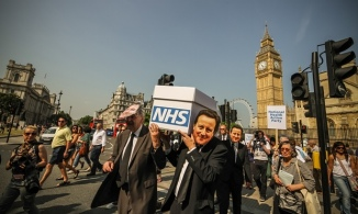 Members of the National Health Action party protest against the gradual privatisation of the NHS, in 2013. Photograph: Guy CorbishleyFlickr Vision